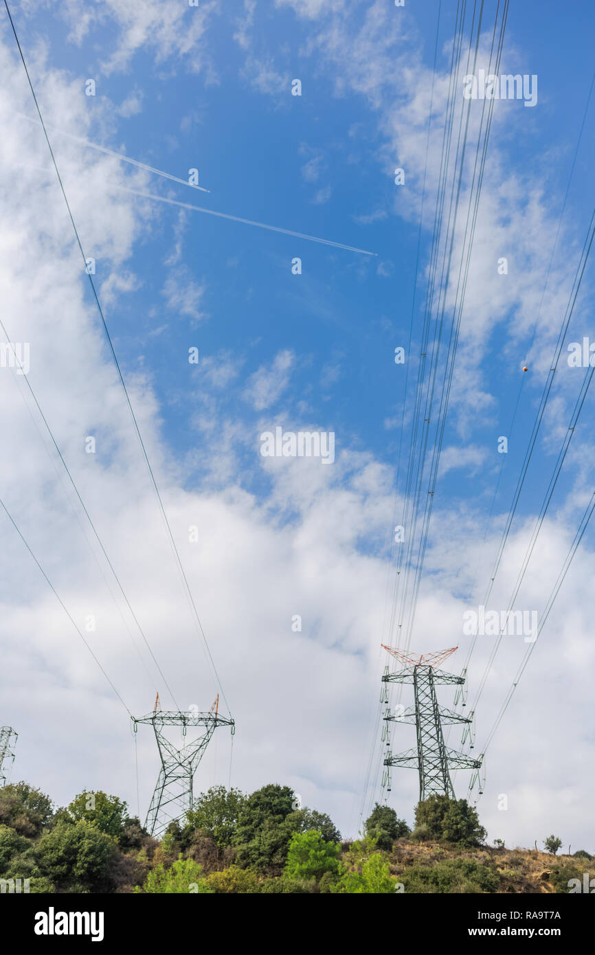 Electricity Transmission Towers Against Blue Sky Background Vertical Color Photography Stock Photo Alamy