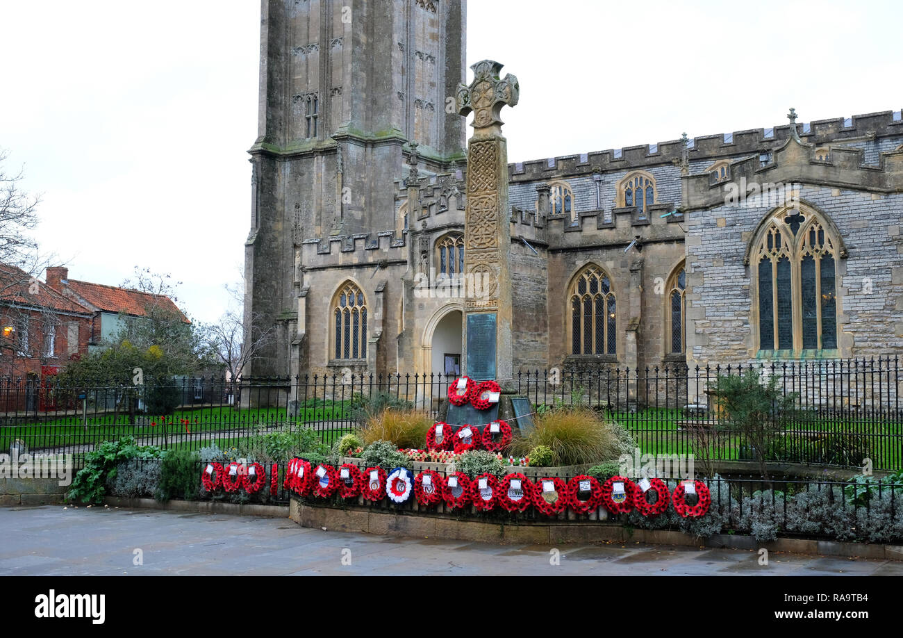 Poppy wreaths outside the Church of St. John the Baptist, commemorating the centenary of Armistice Day, Glastonbury, Somerset, UK - John Gollop - Stock Image