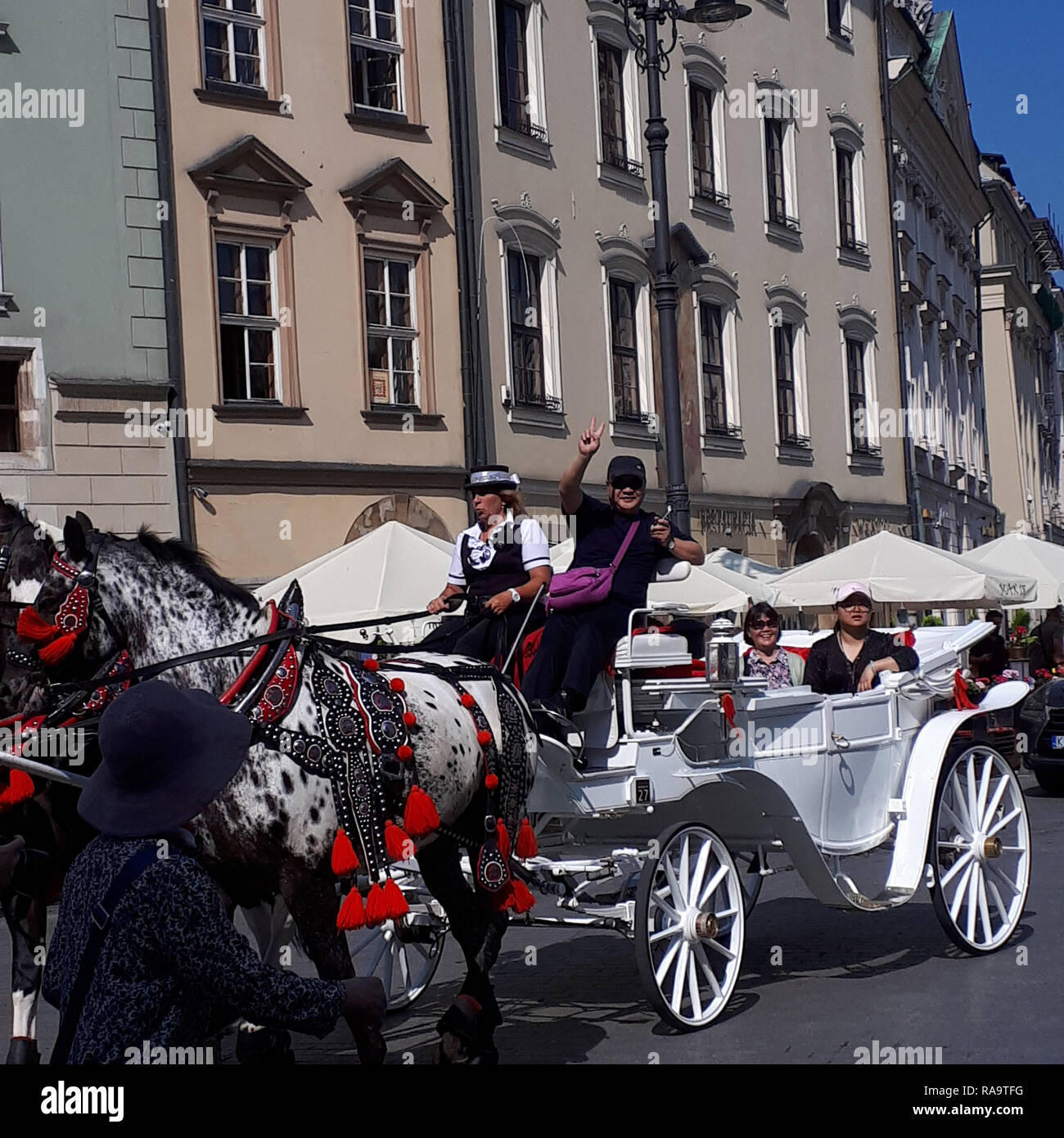 Carriage ride around the city centre streets of Krakow in Poland - Stock Image