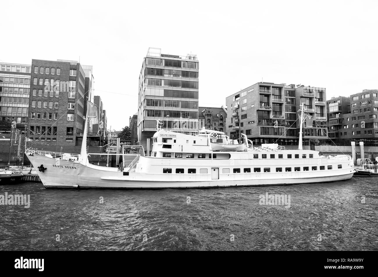 Hamburg, Germany - September 07, 2017: River transport, transportation. Ship at ferry pier on cityscape background. Water travel, travelling trip Vacation discovery wanderlust Stock Photo