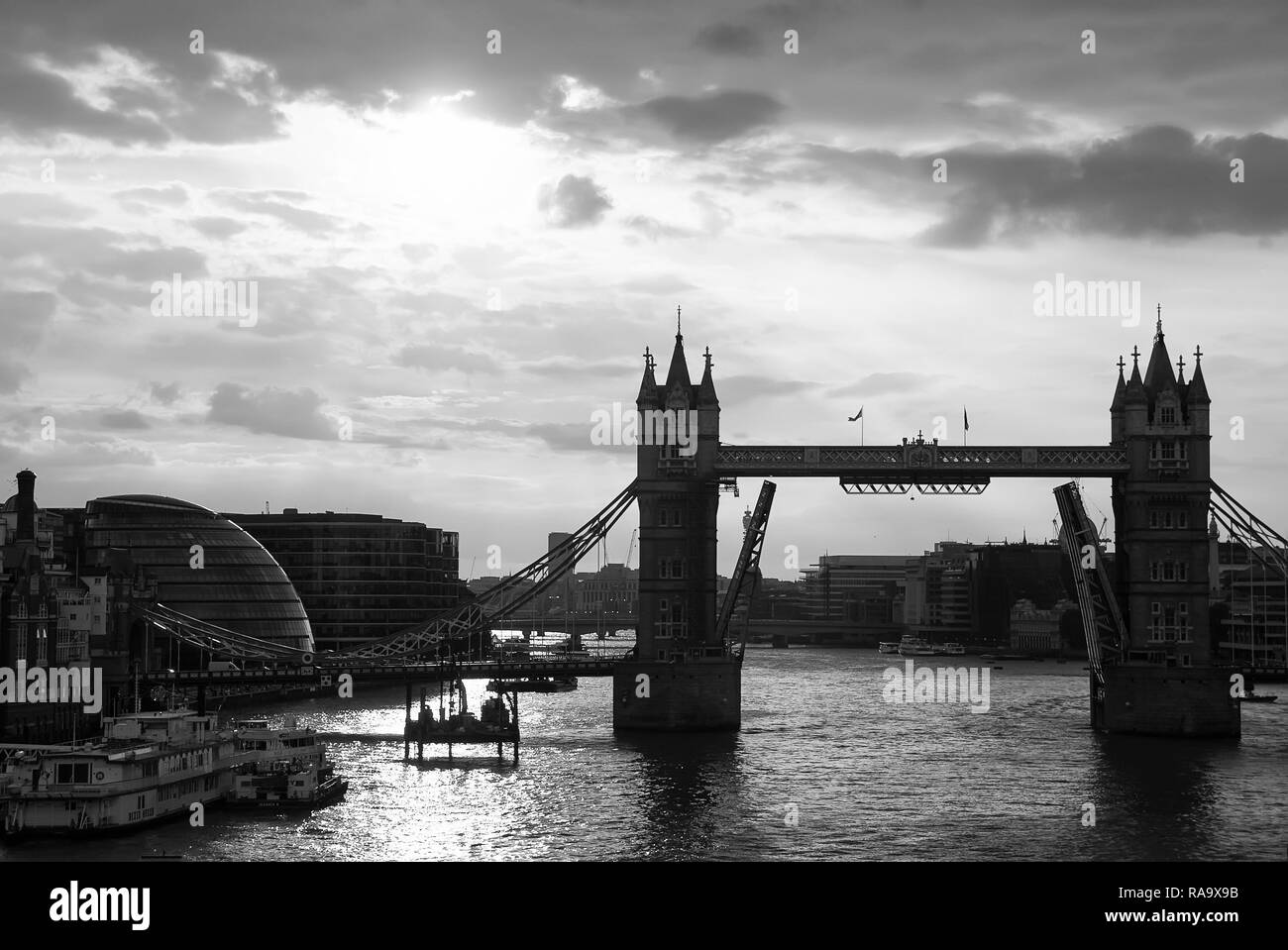 Tower bridge with skyline London, United Kingdom. Bridge over Thames river on cloudy sky. City buildings on river banks. Architecture and structure concept. Wanderlust and vacation. - Stock Image