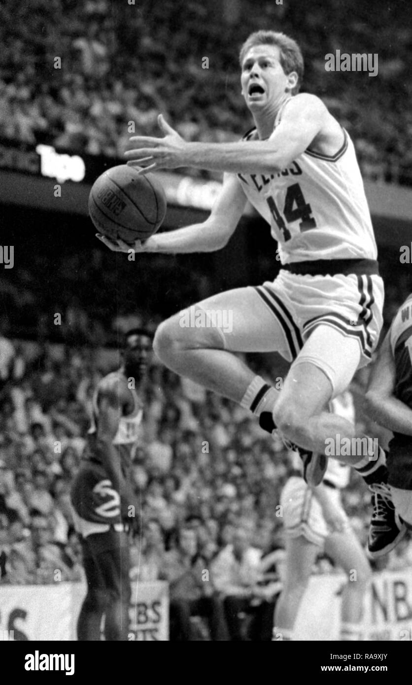 Boston Celtics Danny Ainge scores against the Atlanta Hawks in game action at the Boston Garden in Boston Ma USA 1986 season  photo by bill belknap - Stock Image