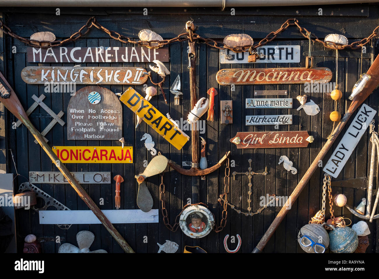 Old boat nameplates attached to a door near the harbourmasters house in Dysart, near Kirkcaldy, Scotland. - Stock Image