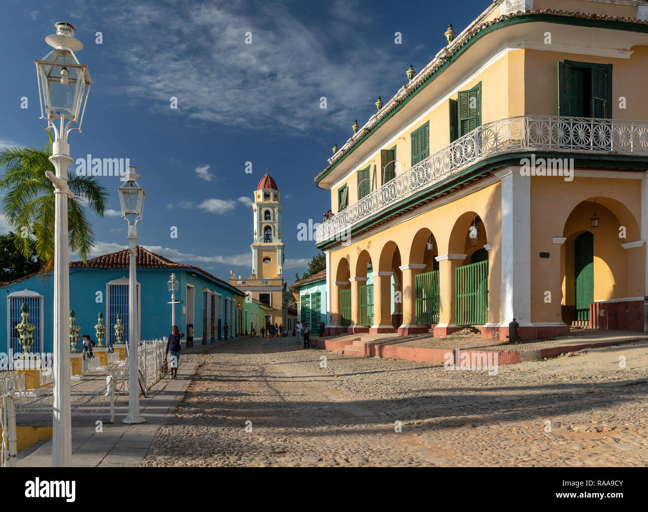 Palacio Brunet and San Francisco tower in late afternoon light at Plaza Mayor, Trinidad, Cuba - Stock Image