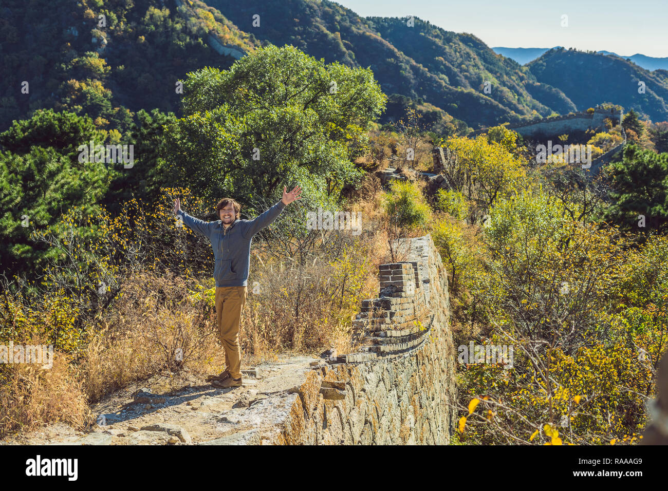 Happy Cheerful Joyful Tourist Man At Great Wall Of China Having Fun On Travel Smiling Laughing And Dancing During Vacation Trip In Asia Man Visiting And Sightseeing Chinese Destination Stock Photo