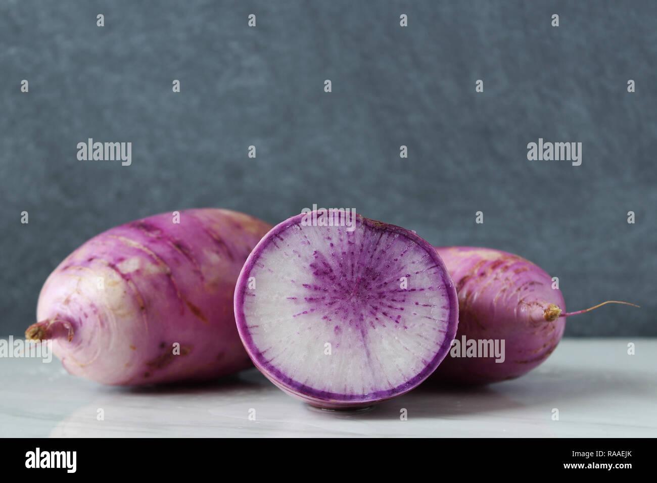 Purple radish whole and cross section. Blackboard copy space. - Stock Image
