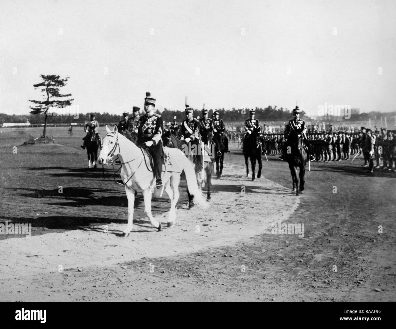 Japanese Emperor Hirohito reviews troops aboard his imperial stallion Shirayuki, ca. 1933. - Stock Image
