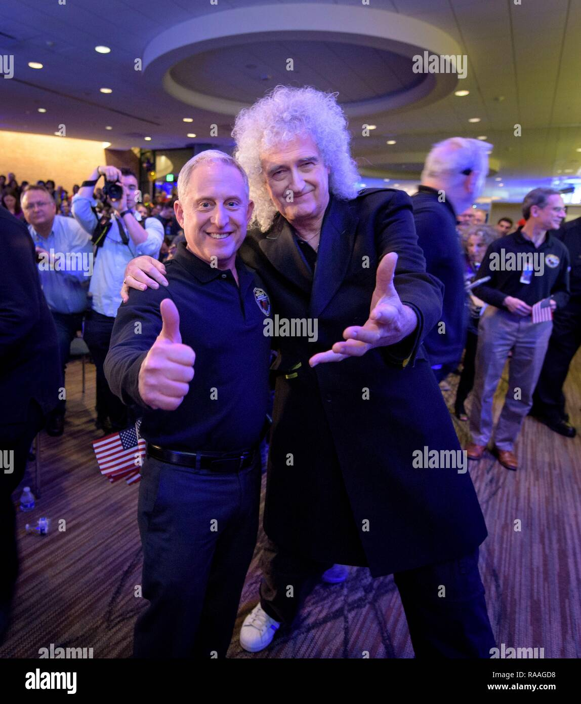 Brian May, lead guitarist of the rock band Queen and astrophysicist, right, poses with New Horizons principal investigator Alan Stern of the Southwest Research Institute as they wait for confirmation of the flyby of Ultima Thule by the New Horizon spacecraft at Johns Hopkins University Applied Physics Laboratory December 31, 2018 in Laurel, Maryland. The flyby by the space probe occurred 6.5bn km (4bn miles) away, making it the most distant ever exploration of an object in our Solar System. - Stock Image