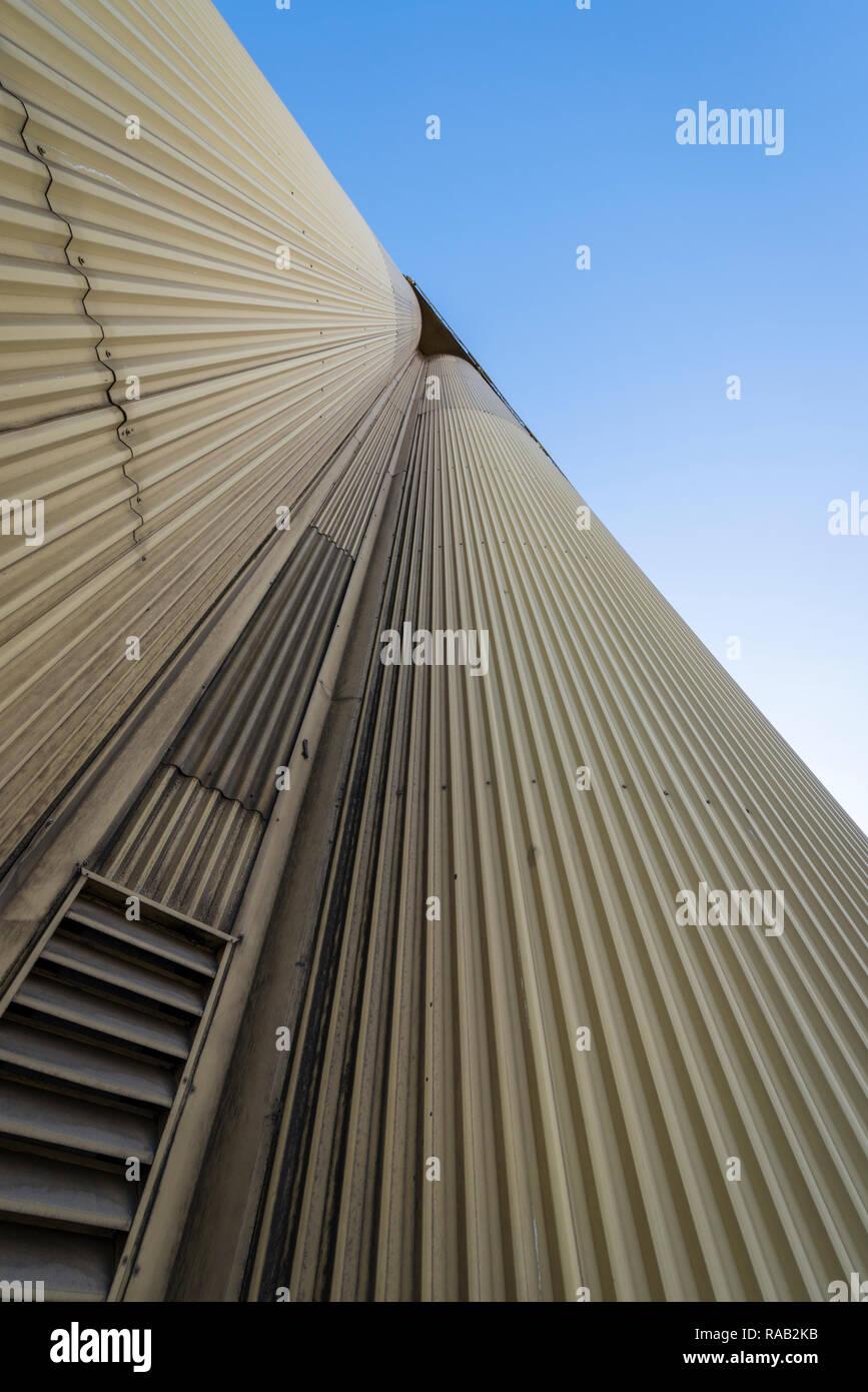 Industrial grain silos against a blue sky Stock Photo