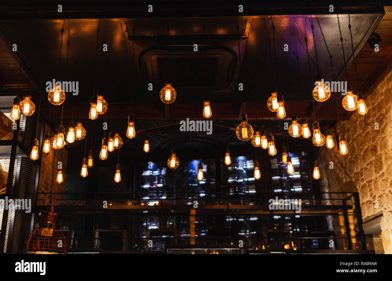 Many Electrical Lamps Bulbs Hanging From Ceiling At Restaurant Interior And Glowing In Darkness Dark Background Horizontal Color Photography Stock Photo Alamy