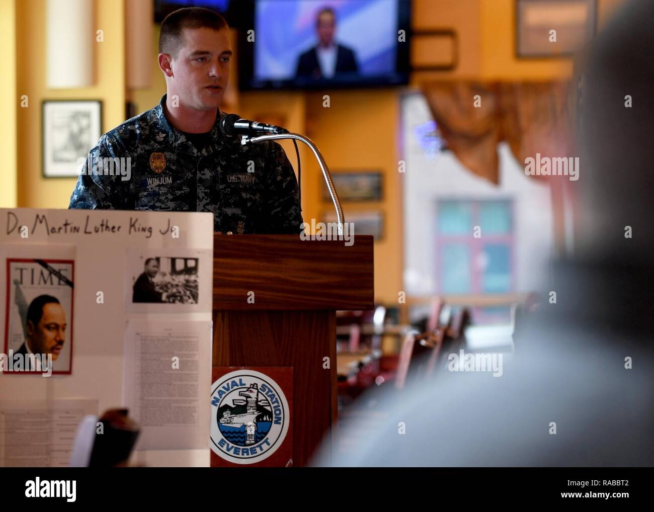EVERETT, Wash. (Jan. 13, 2017)  Master-at-Arms 1st Class John Winjum, assigned to Naval Station Everett (NSE) Security Forces, speaks at a Martin Luther King Jr. Day remembrance ceremony at the All-American Restaurant on base. Dr. King was a civil rights activist who worked to end racial segregation in the United States. - Stock Image