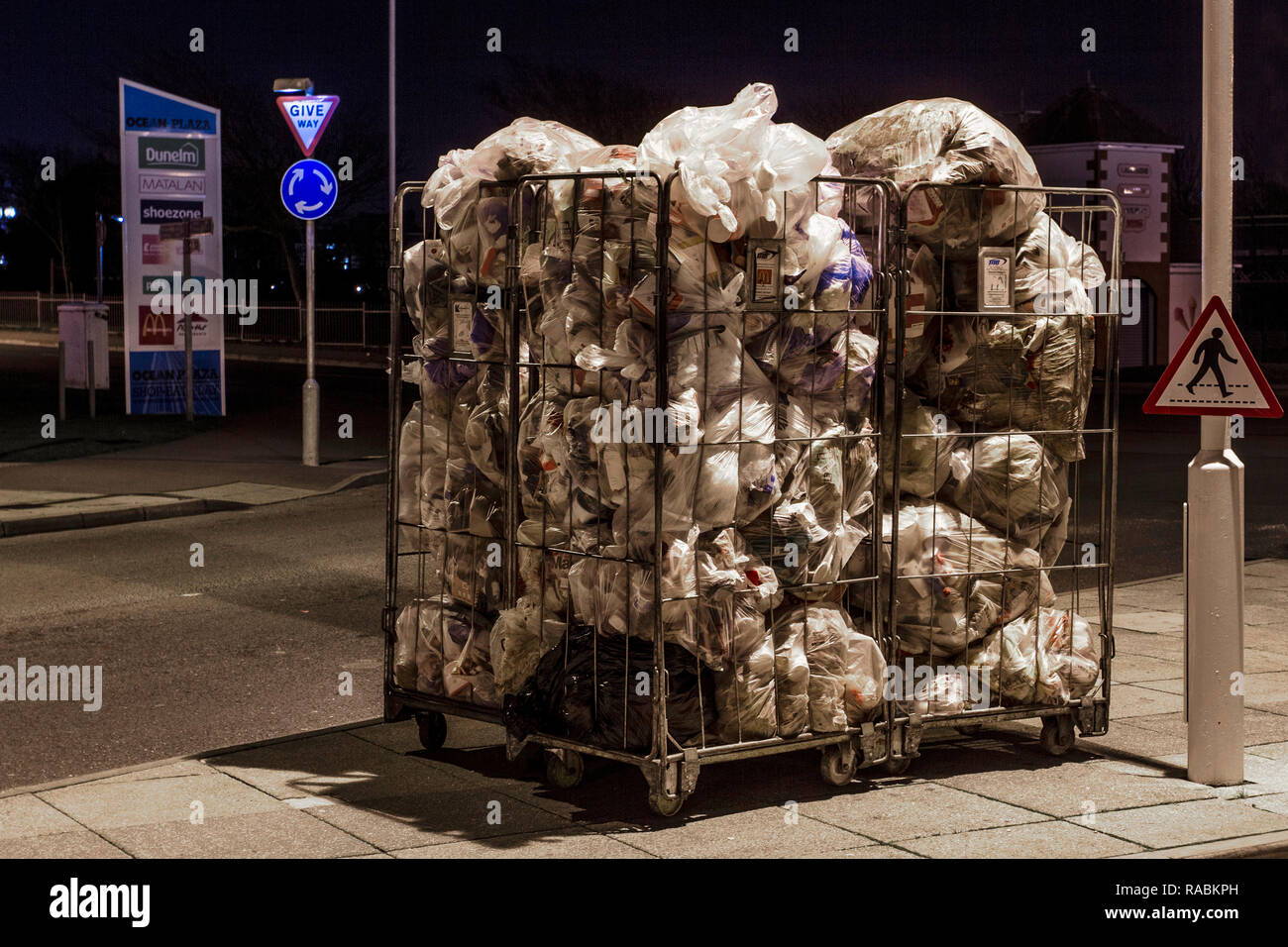 Southport, Merseyside, UK. 3rd Jan, 2019. Bags of daily Retail Waste awaiting collection. Take-away coffee cups & plastic culinary items from commercial food premises bagged and awaiting collection at dawn in town centre retail park. Credit: MediaWorldImages/Alamy Live News Stock Photo