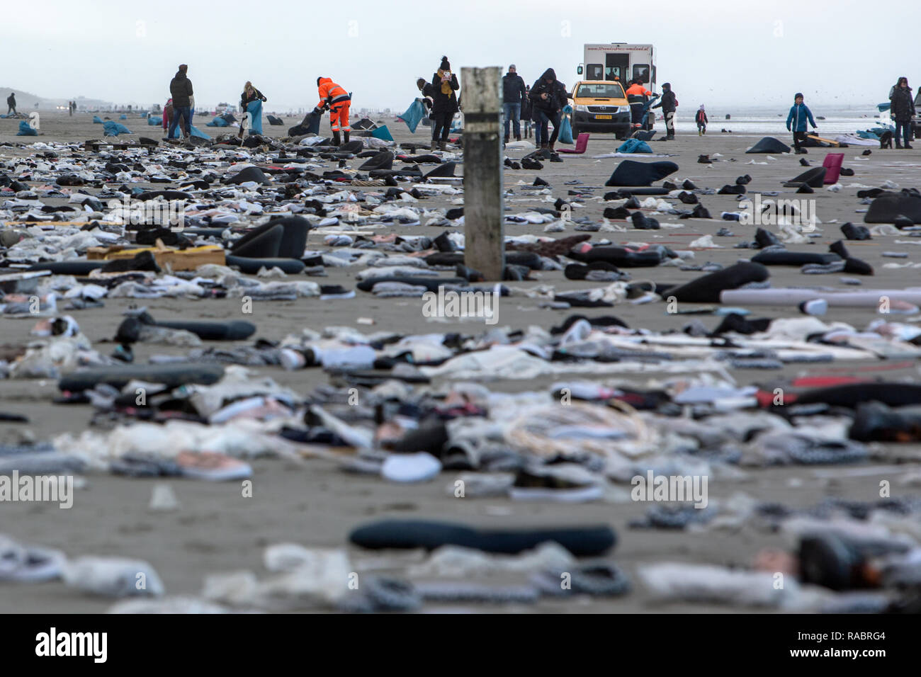 Ameland, Netherlands. 02nd Jan, 2019. Volunteers collect goods washed up on the beach at Midsland aan Zee on the Dutch island of Ameland, which come from MSC Zoe containers that have gone overboard. Approximately 300 pieces had gone overboard in the night to 03.01.2019, the freight should also contain dangerous goods. Credit: Jan Spoelstra/dpa/Alamy Live News - Stock Image