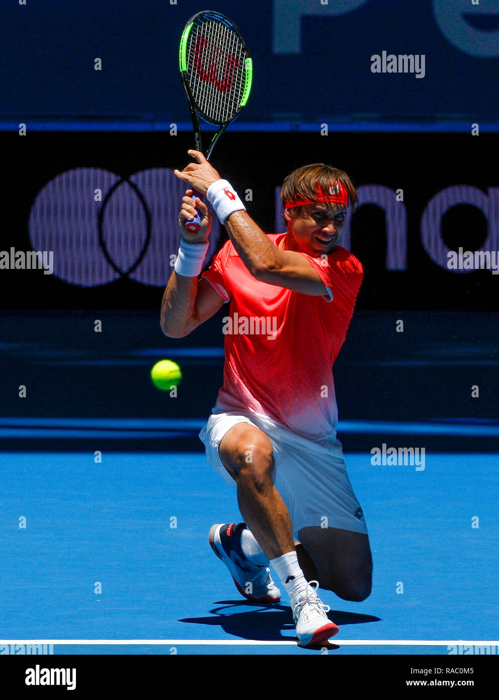 RAC Arena, Perth, Australia. 4th Jan, 2019. Hopman Cup Tennis, sponsored by Mastercard; David Ferrer of Team Spain hits a low running plays a backhand shot against Lucas Pouille of Team France Credit: Action Plus Sports/Alamy Live News - Stock Image