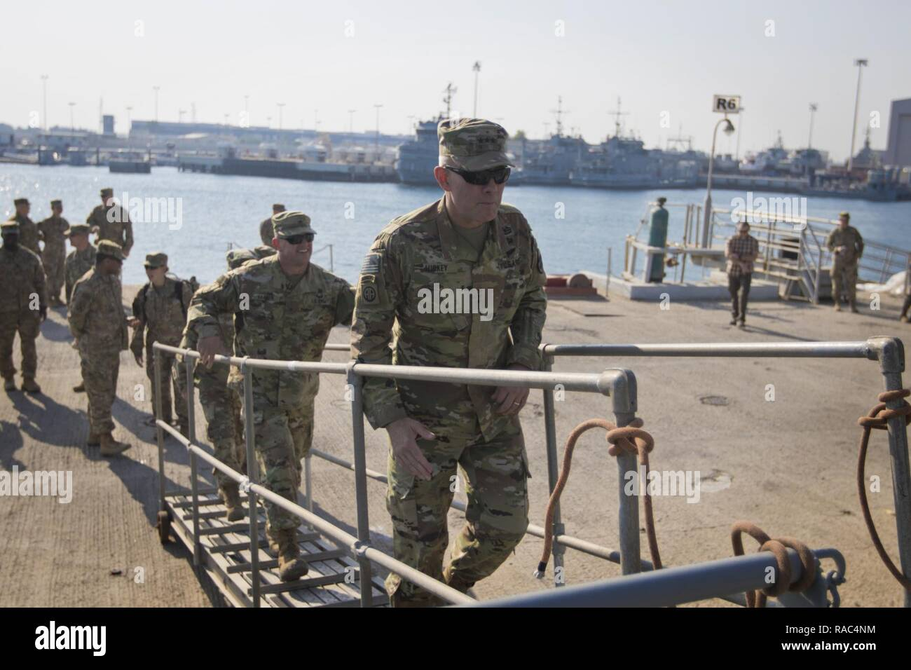 """U.S. Army Reserve Commanding General Lt. Gen. Charles D. Luckey steps aboard the LCU-2002 """"Kennesaw Mountain"""" during a tour of the Kuwait Naval Base and its capabilities in Kuwait, Jan. 10, 2017. - Stock Image"""