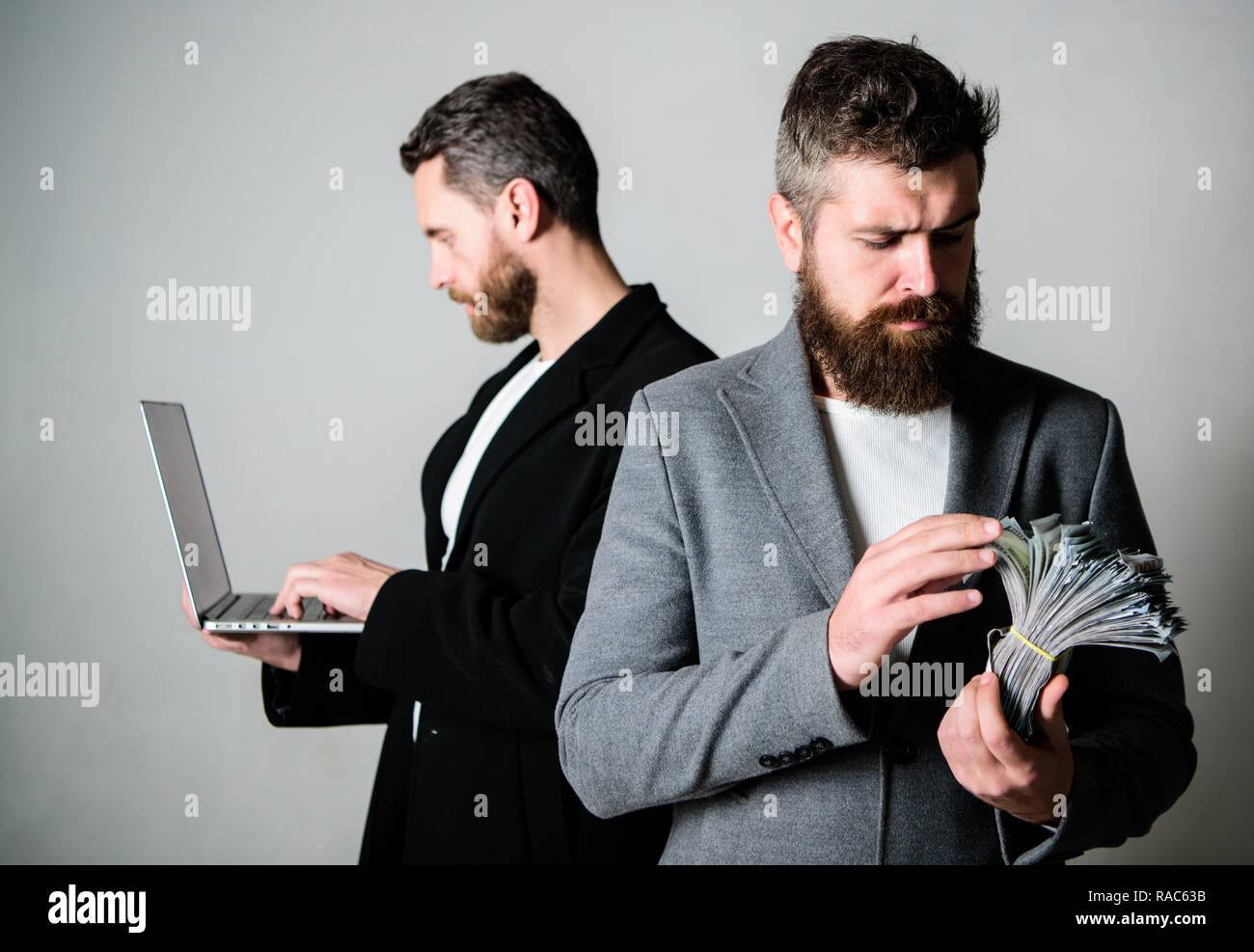 Developing applications. Digital technology. IT business. Online business. Earn money online business. They know how to make money. Team of web developer with laptop and sales manager with cash money. - Stock Image