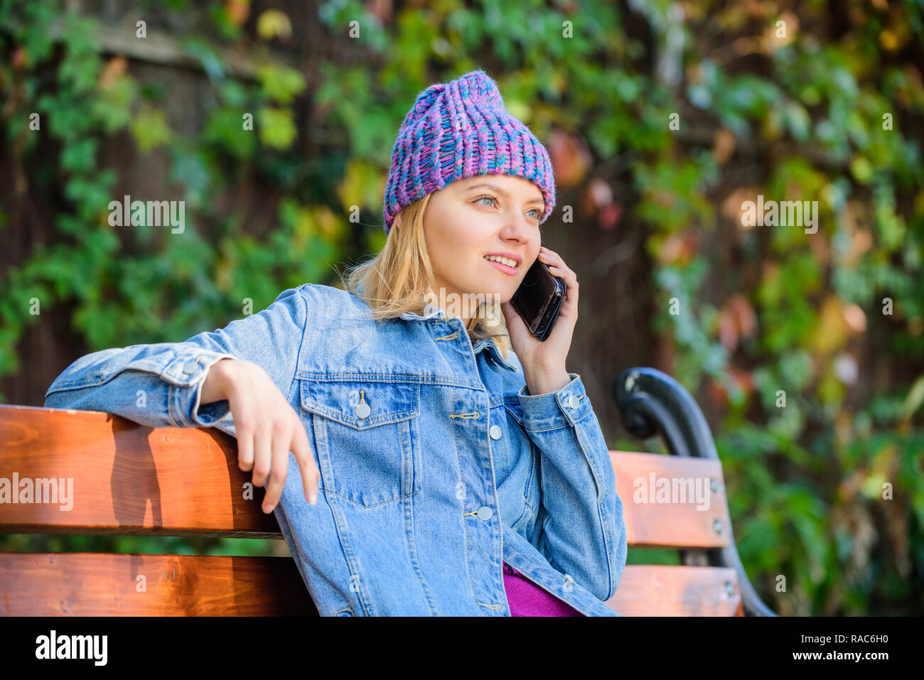 I am waiting for you in park. Girl busy with smartphone green nature background. Woman having mobile conversation. Girl smartphone call friend. Stay touch with modern smartphone. Mobile call concept. - Stock Image
