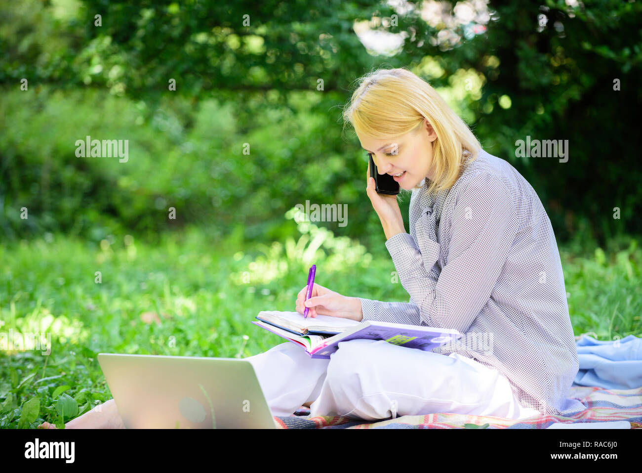 Modern technology give more opportunities to realize your potential. Woman with laptop and smartphone working outdoors. Girl use modern technology for business. Use opportunity digital technology. - Stock Image