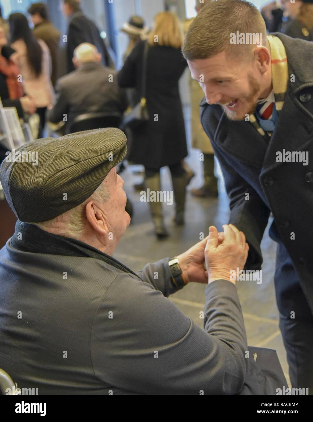 Former U.S. Army Spc. Kenneth Stumpf, Medal of Honor recipient and retired U.S. Marine Corps Cpl. William Kyle Carpenter, Medal of Honor recipient, exchange coins during a traditional Inaugural Day Medal of Honor breakfast held at the Reserve Officers Association headquarters in Washington D.C., January 20, 2017. Stock Photo