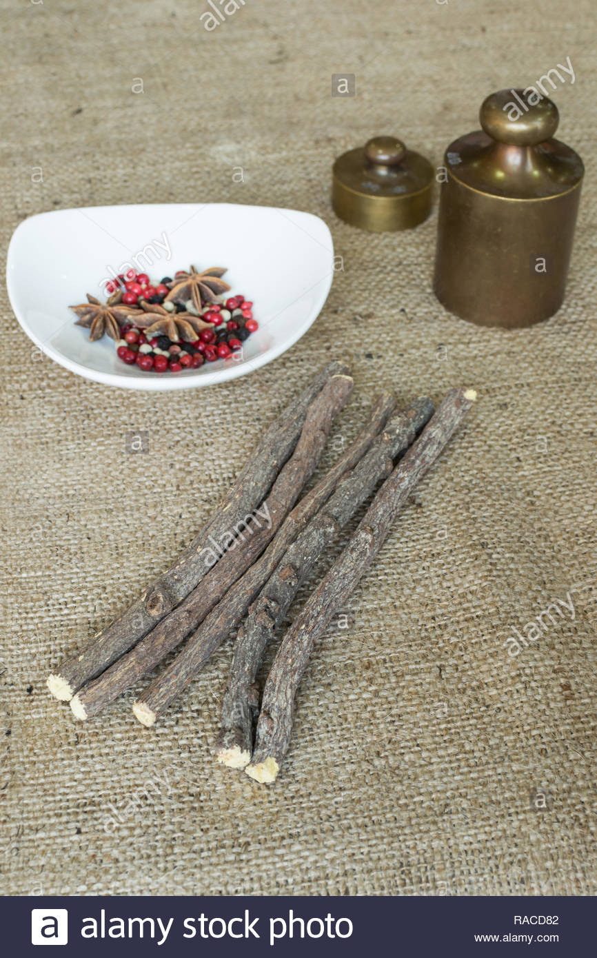 liquorice root sticks on textile background - Stock Image