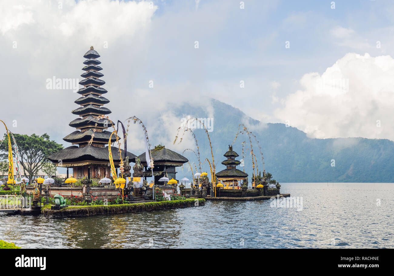 Pura Ulun Danu Bratan, Bali. Hindu temple surrounded by flowers on Bratan lake, Bali. Major Shivaite water temple in Bali, Indonesia. Hindu temple Stock Photo