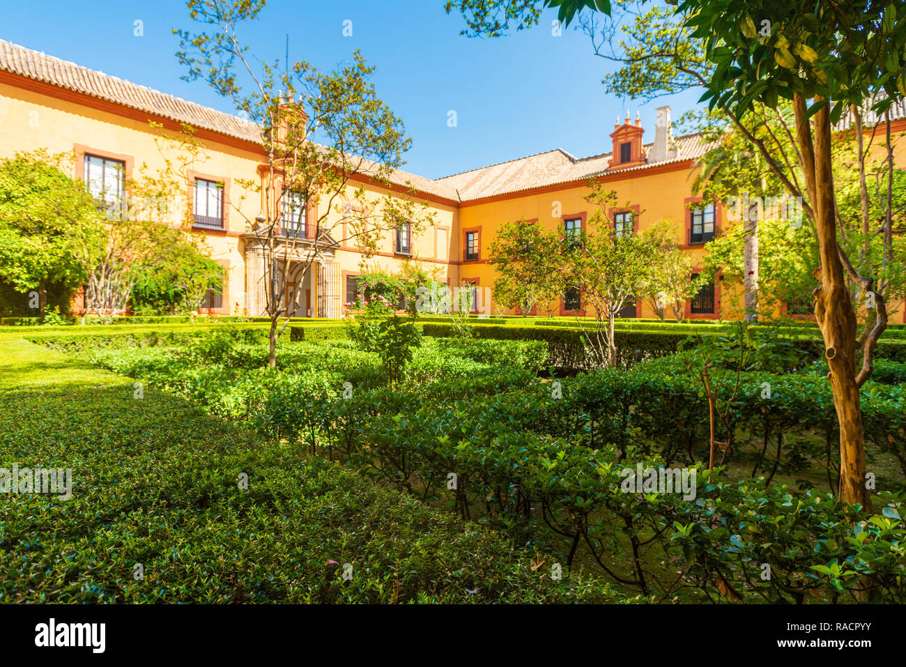 Lush gardens and hedges in the courtyards and outdoor areas of the Real Alcazar, UNESCO World Heritage Site, Seville, Andalusia, Spain, Europe - Stock Image