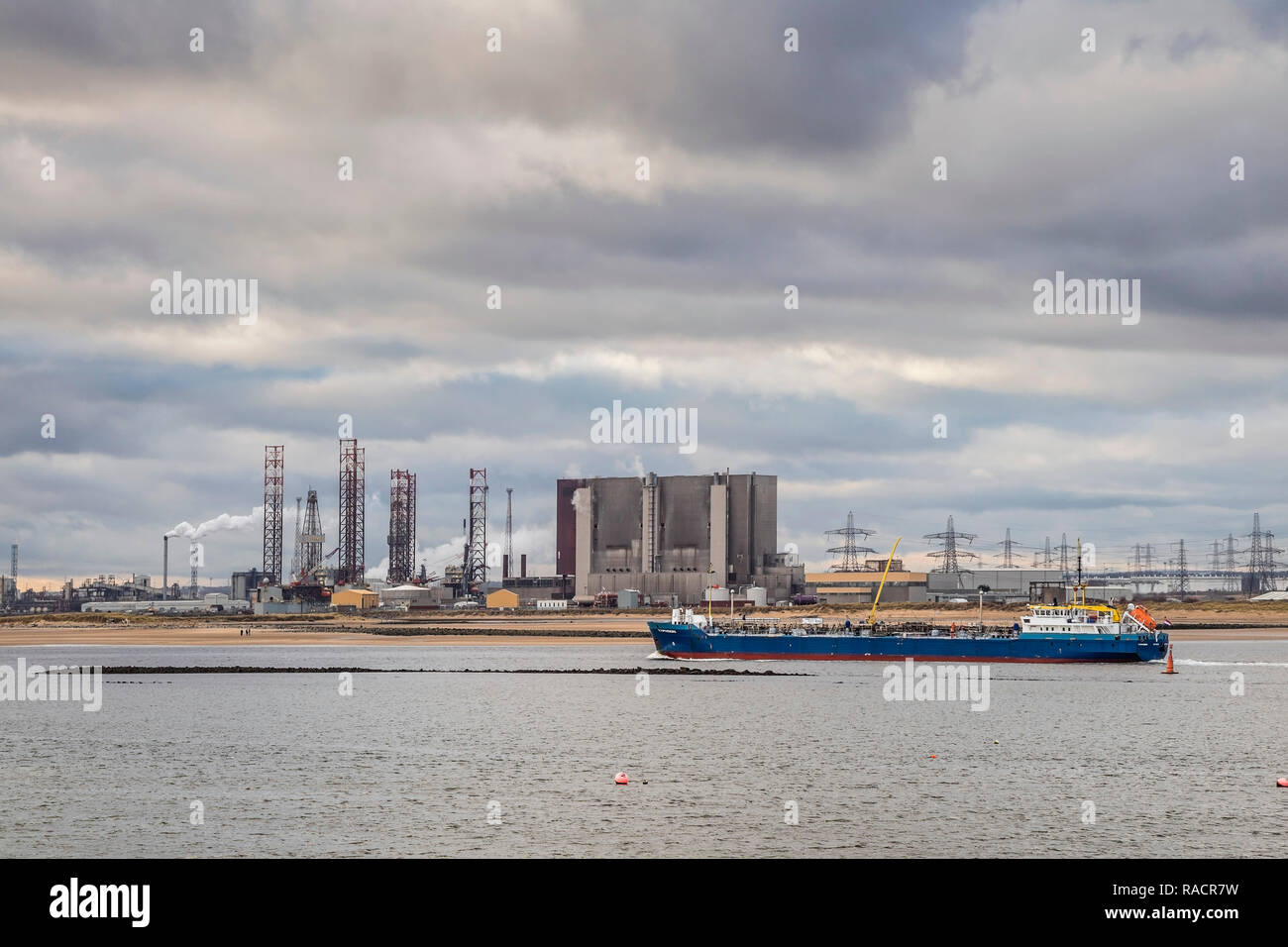 The LPG Tanker, Typhoon Passing Hartlepool Advanced Gas Cooled Reactor Nuclear Power Station, Teesmouth, North East England, UK, - Stock Image