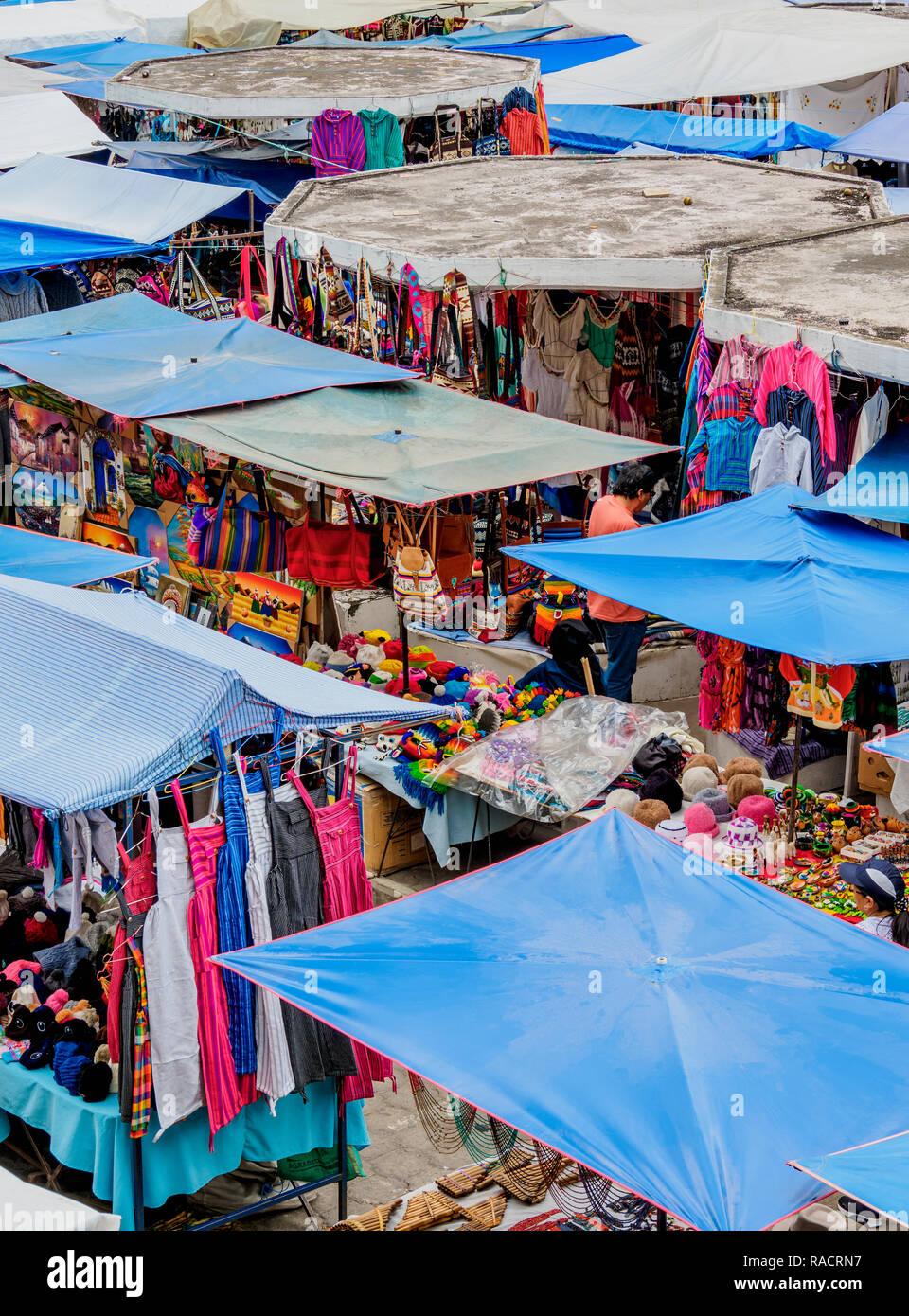 Saturday Handicraft Market, Plaza de los Ponchos, elevated view, Otavalo, Imbabura Province, Ecuador, South America - Stock Image