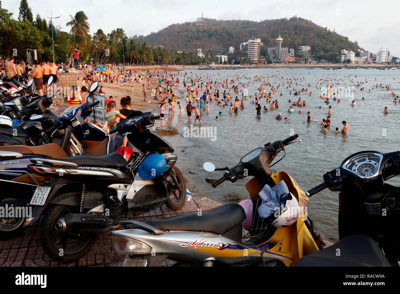 Sunday at the beach, Vietnamese families swimming in the South China Sea, Hang Dua Bay, Vung Tau, Vietnam, Indochina, Southeast Asia, Asia - Stock Image