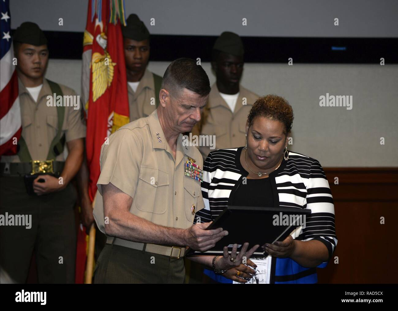 Kim Fountaine, right, accepts a certificate on behalf of her father, U.S. Marine Corps Pfc. Charles Robert Fountain, from Lt. Gen. William D. Beydler, commander of U.S. Marine Forces Central Command, during a Congressional Gold Medal ceremony at MacDill Air Force Base, Fla., Jan. 27, 2017. The certificate was awarded to Fountain who served in the Montford Point Marines, an all African-American unit that was segregated throughout World War II. - Stock Image