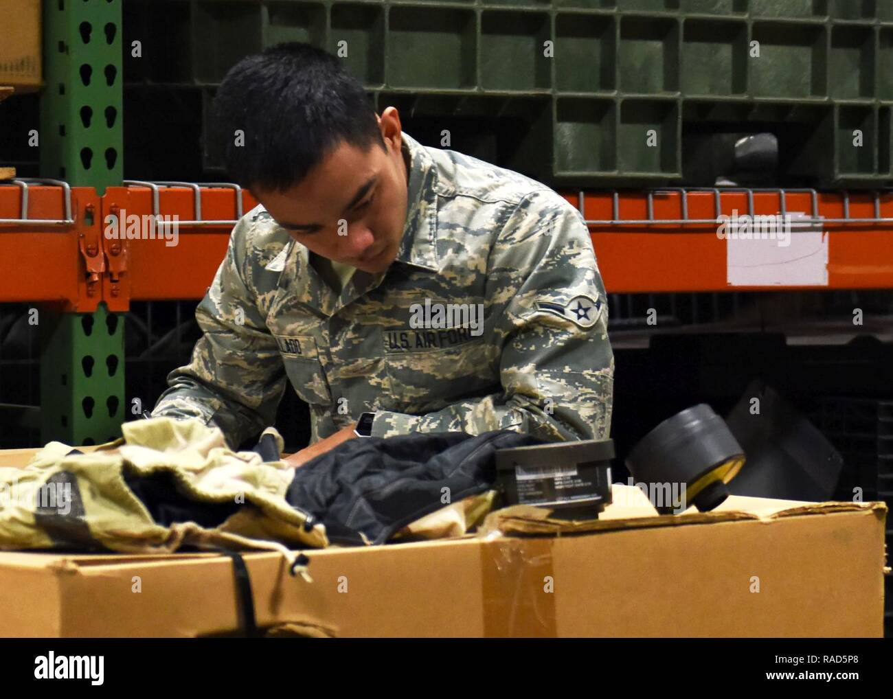 U.S. Air Force Airman Joerimer Collado, an individual protective equipment (IPE) specialist assigned to the 509th Logistics Readiness Squadron (LRS), creates an inventory list for disposition items at Whiteman Air Force Base, Mo., Jan. 17, 2017. When items are no longer needed in the IPE shop they are put into crates to be transferred to another facility. - Stock Image