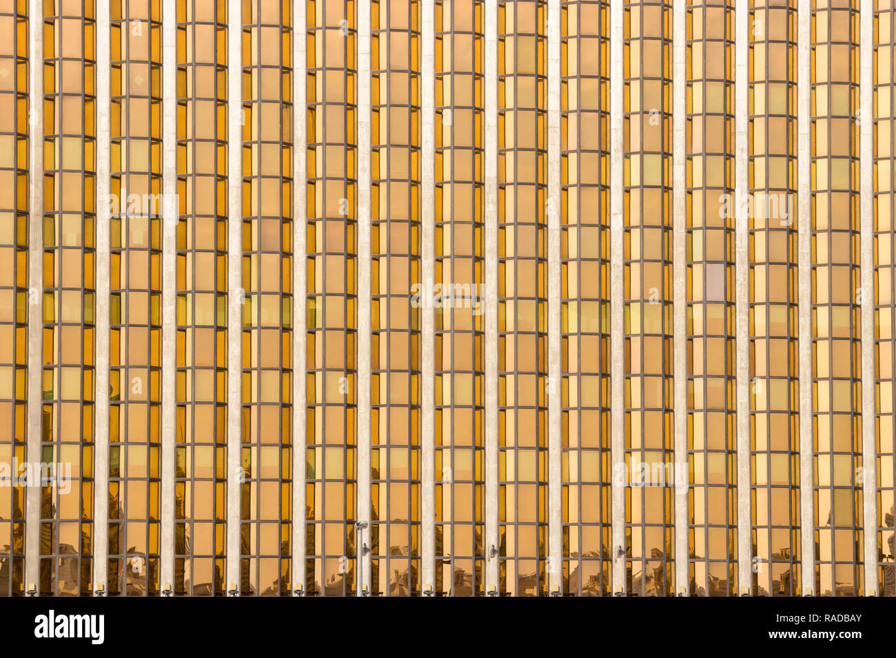 Gold facade from this financial offices building in Dubai - Stock Image