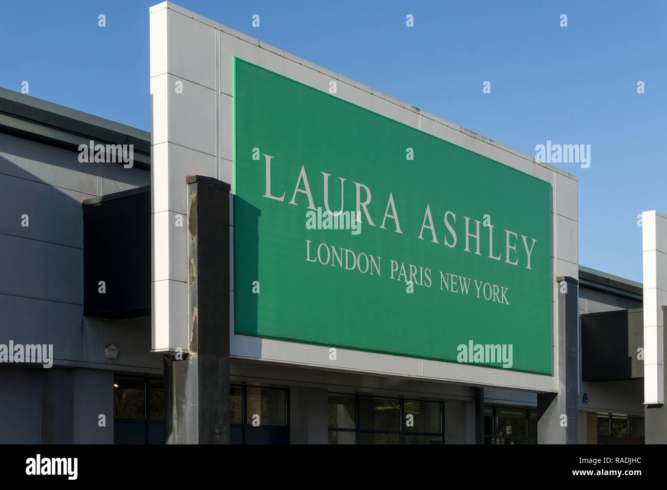 Sign for a Laura Ashley store, a womenswear and homewares chain, St James Retail Park, Northampton, UK - Stock Image