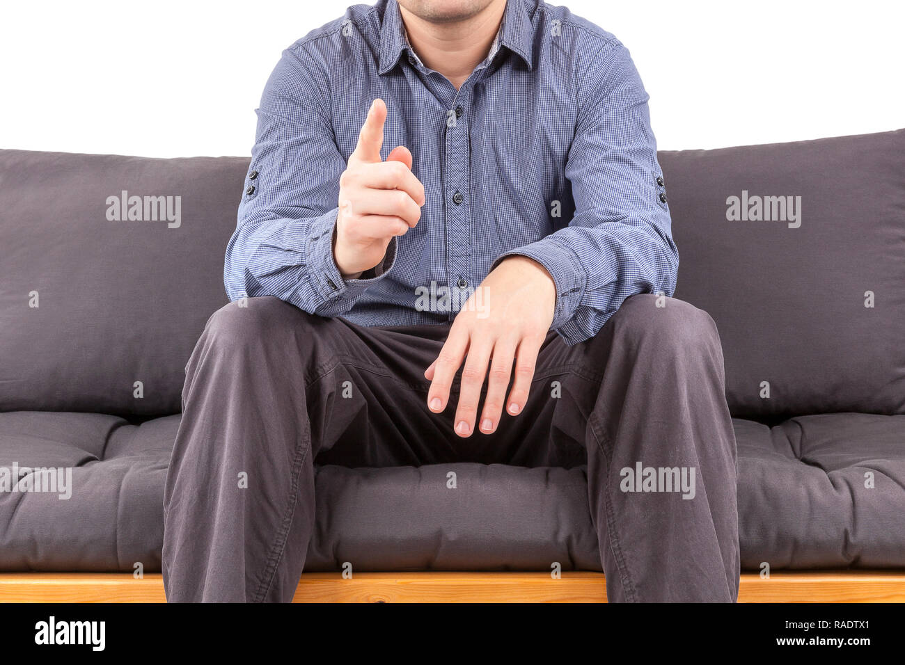 Manager on sofa raising finger in warning gesture. Mentor and leadership concept. - Stock Image