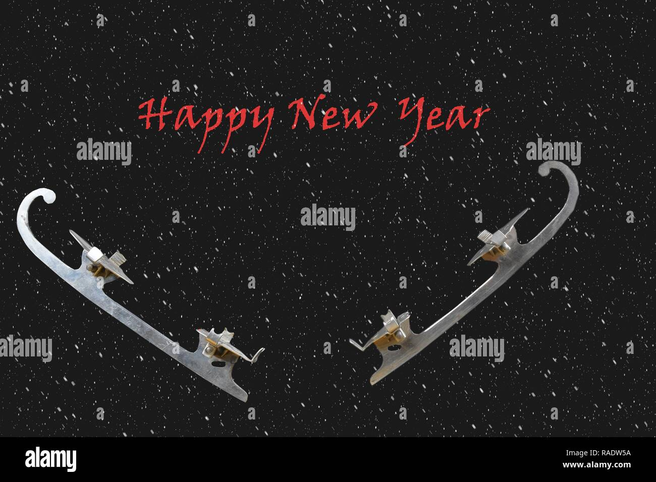 Vintage ice-skate on black background with snow effect. Text - Happy New Year. Copy space - Stock Image