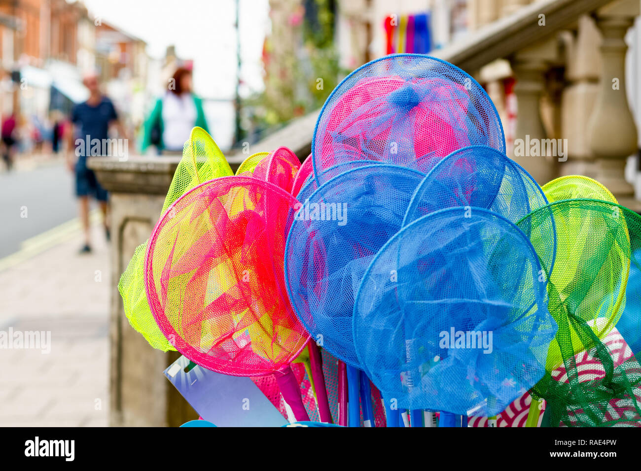 Colourful telescopic fishing nets on display for sale in the popular seaside town Southwold of the UK Stock Photo
