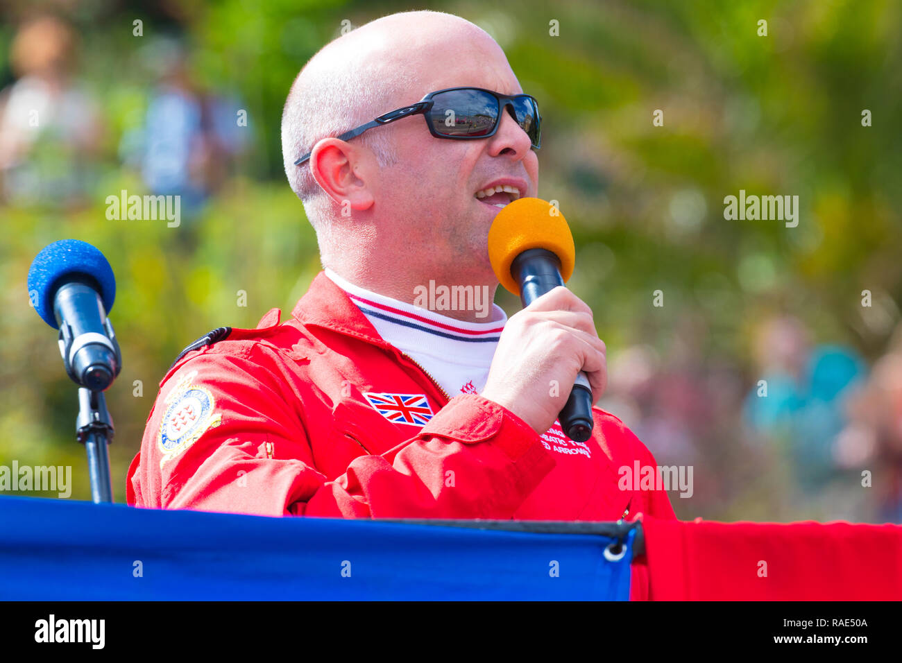 Red Arrows squadron supervisor Red 10 Mike Ling giving a running commentary on one of the teams displays at Scarborough during Armed Forces Day. - Stock Image