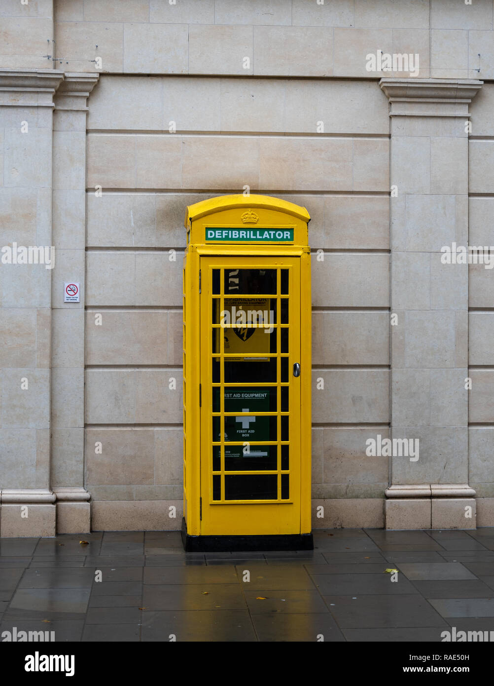 Bath, United Kingdom - October 13 2018:   An old phone box painted yellow and converted to use for First aid and defibrillation in Southgate Street - Stock Image