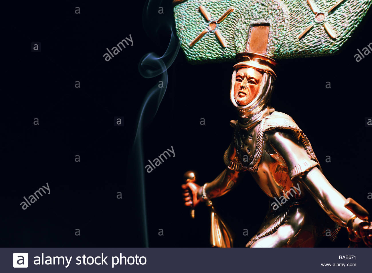 shaman figure smoke dark background - Stock Image