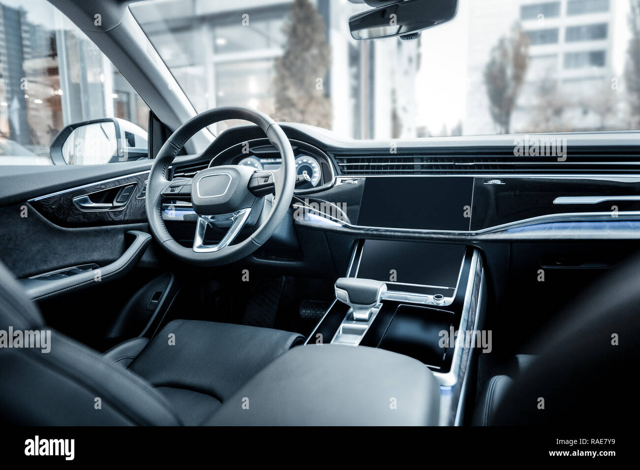 Modern passenger car with black leather interior standing outside - Stock Image