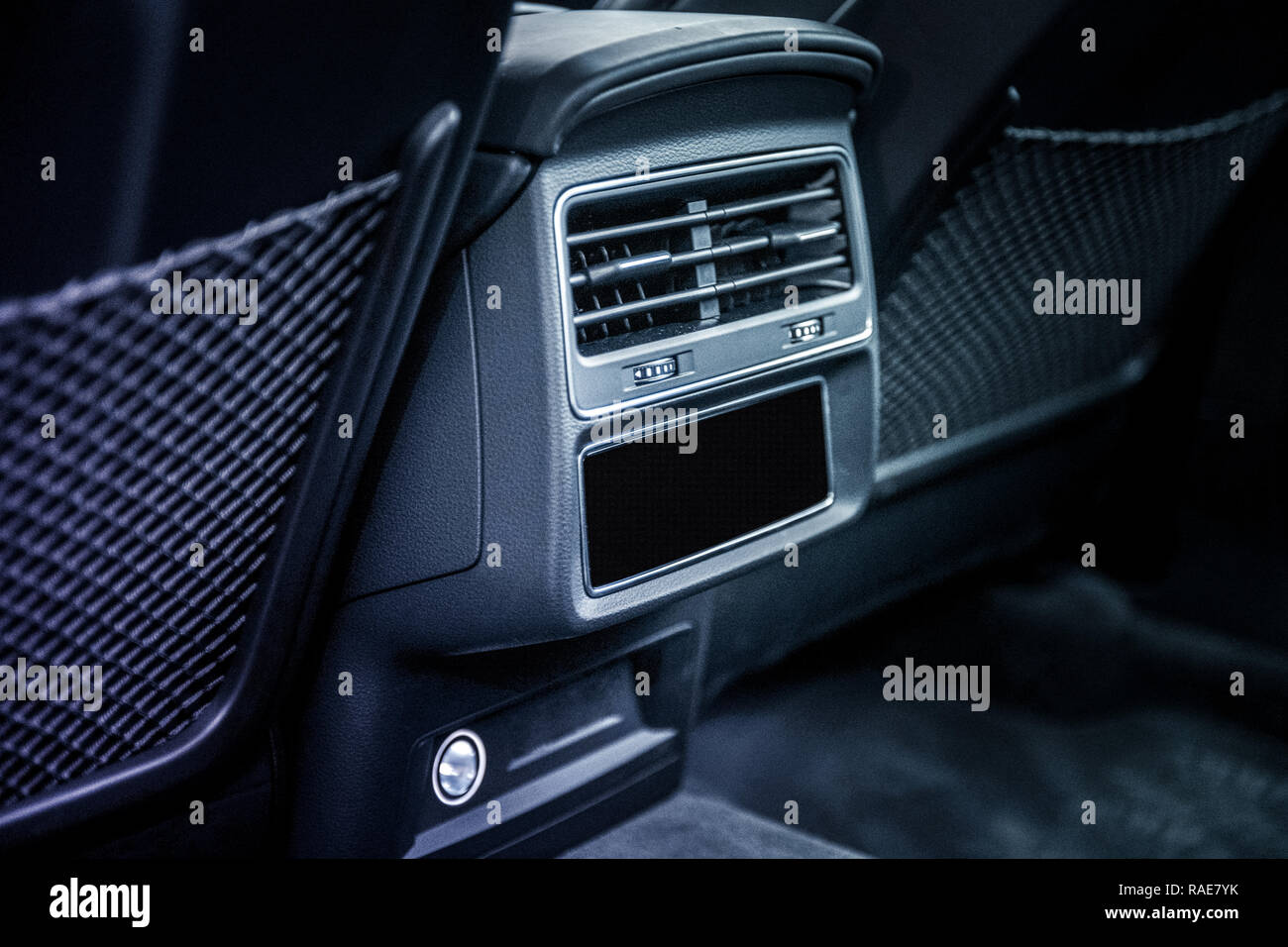 Close up of air conditioning system in car with leather interior - Stock Image