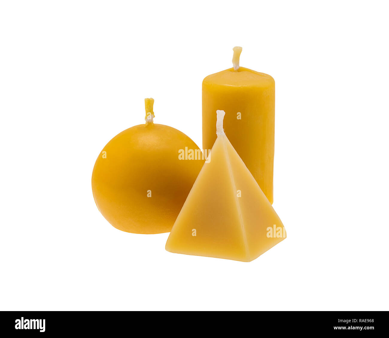 Three golden beeswax candles isolated on white background - Stock Image