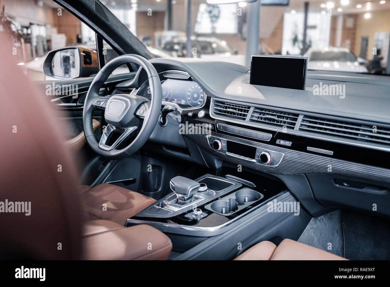 Close up of modern leather interior in new hatchback car - Stock Image