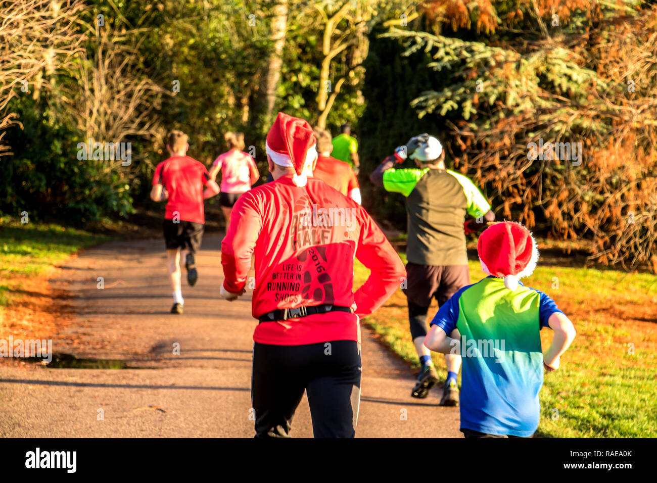 Christmas Parkrun.Father And Son Running In A Parkrun At Bedford Park At