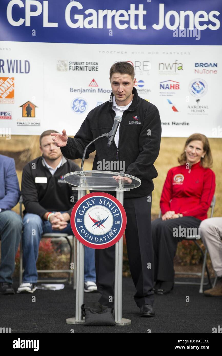 Retired U.S. Marine Corps Cpl. Garrett Jones speaks during the Smart Home dedication ceremony at his new home in Stafford, Va., Jan. 19, 2017. Jones received the home from the Gary Sinise Foundation, which began building specially adapted smart homes for America's severely wounded veterans through its partner programs in 2012. Stock Photo