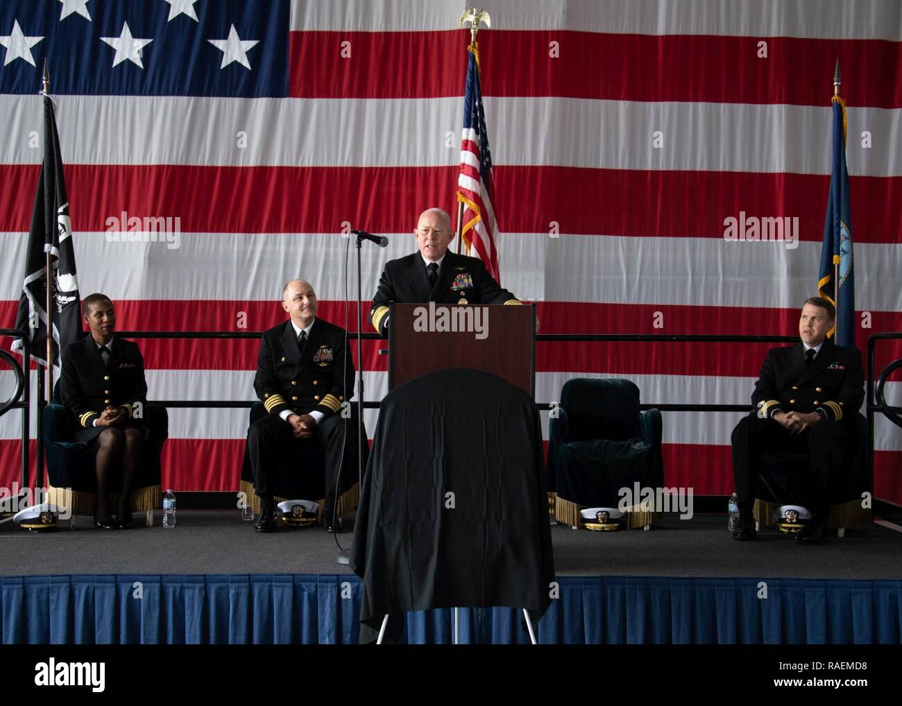 """CORONADO, Calif. (Dec. 14, 2018) Vice Adm. DeWolfe H. Miller III, Commander, Naval Air Forces, speaks at the establishment ceremony of Fleet Logistics Multi-Mission Squadron 30 """"Titans"""" (VRM-30). VRM-30 is the Navy's first CMV-22B Opsrey squadron and was established to begin the Navy's transition from the C-2A Greyhound. U.S. Navy - Stock Image"""