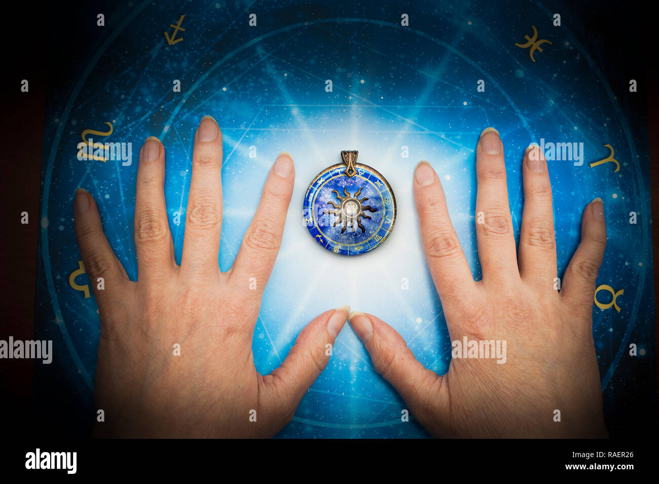 hands of an astrologer, fortune telling according to the stars concept - Stock Image