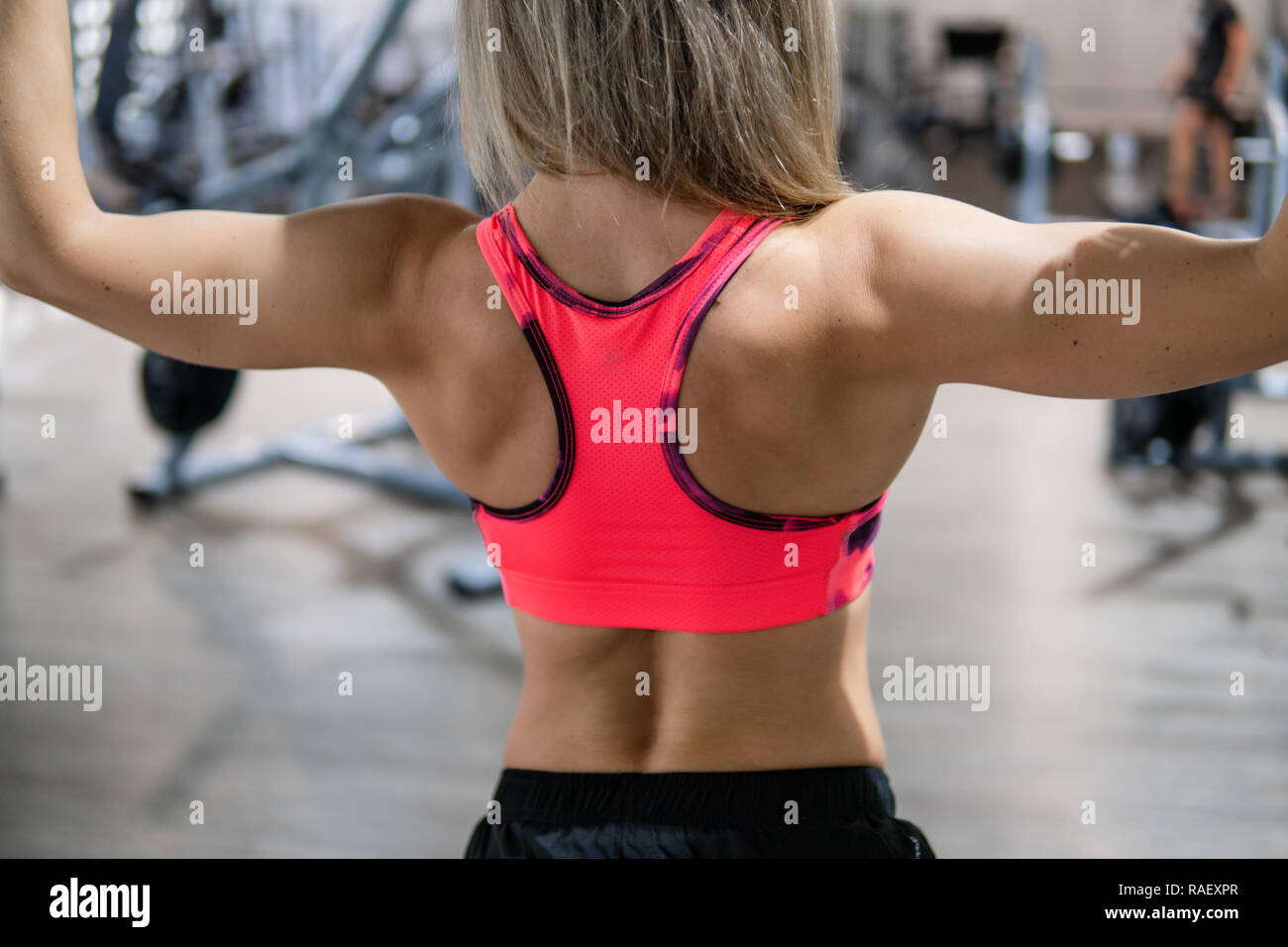 Fitness trainer looks into the camera in the gym Stock Photo