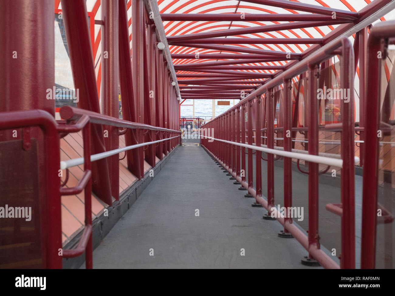 Gangway leading down to the ferry terminal, Woodside, Birkenhead on the river Mersey - Stock Image