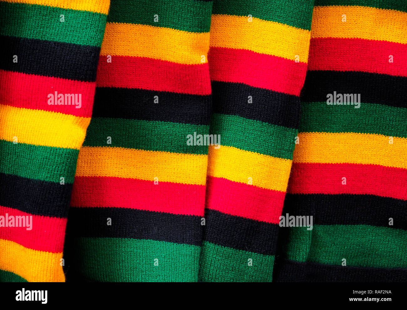 Colored background made of some wool socks on sale in a street market - Stock Image